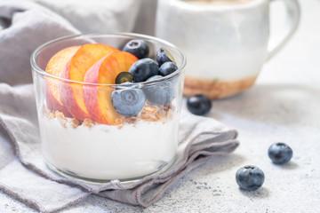 granola and yogurt with fresh berries