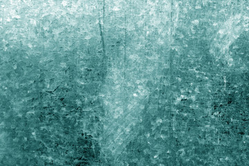 Old metal surface with scratches in cyan tone.