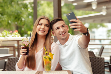 couple using mobile phone in cafe