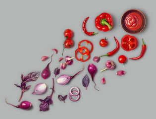 Healthy eating. Vegetables red and violet: pepper, tomato, onion, basil, on a gray background. Photo studio. Healthy food, top view. Product with high resolution