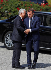"French President Macron is welcomed by Portuguese PM Costa before a town hall on ""European challenges"" with citizens at the Gulbenkian Foundation in Lisbon"