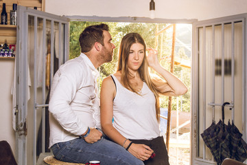 Guy and girl looking at each other in love at home