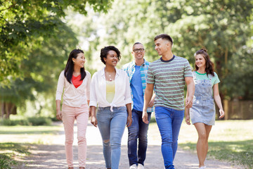 people, friendship and international concept - group of happy friends walking in park Wall mural