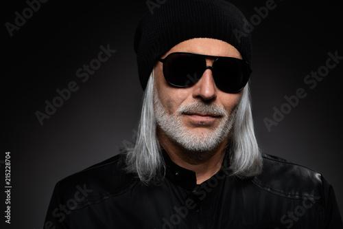 Serious bearded man wearing sunglasses. Studio shot
