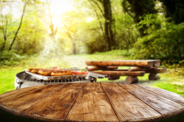 Table background of free space for your decoration and grill time in garden.