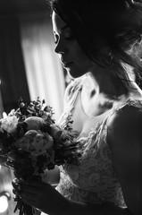 Luxury bride in wedding dress on beautiful background