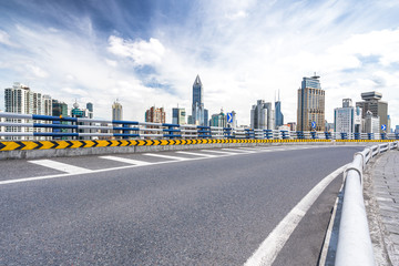 city skyline with asphalt road in urban