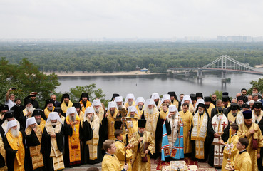 Clergymen take part in a ceremony marking the anniversary of the Christianisation of the country in Kiev