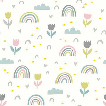 Cute vector pattern with flowers, rainbows and clouds. Spring abstract hand drawn whimsical seamless background in pastel colors.