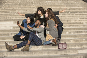 Friends taking selfie with smart phone