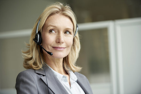 Close-up of telecaller with headset