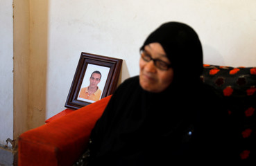 "Photograph of ""Shawkan"" is seen behind interview with his mother in Cairo"