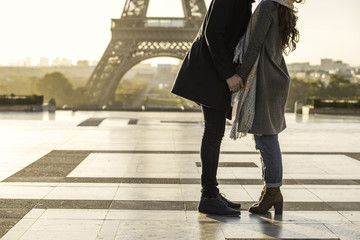 Couple kissing each other at Eiffel Tower