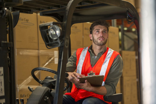 Worker sitting in forklift truck