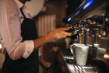 Female barista making a coffee