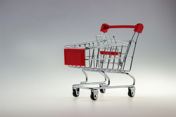 Empty shopping cart for use in market or supermarket in white background isolated.