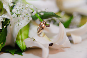 lily flower and wedding rings