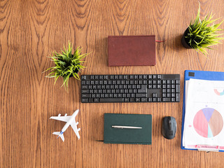 Traveler businessman desktop concept image, books , pen , clipboard, pot of grass