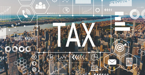 Tax with aerial view of Manhattan, NY skyline