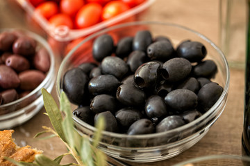 black olives in the bowl served for snack.