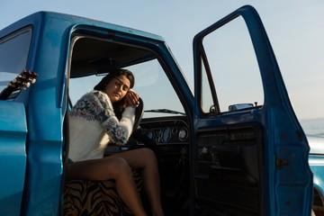 Woman sleeping in a pickup truck