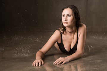 Aqua-zone studio is a lovely charming, serious young girl. On the floor lies a young woman with long dark hair in a black bra and underwear