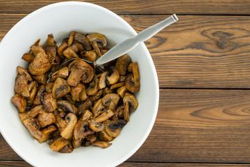 Overhead view of savory mushroom dish with spoon