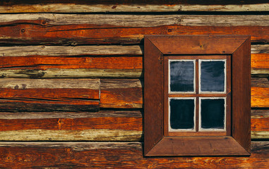old window in a wooden house, ancient rural architecture