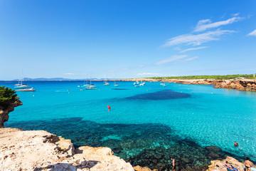 Idyllic beach of Cala Saona from high view angle, Formentera coastline in Balearic Islands, Spain