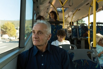 Senior man travelling in the bus