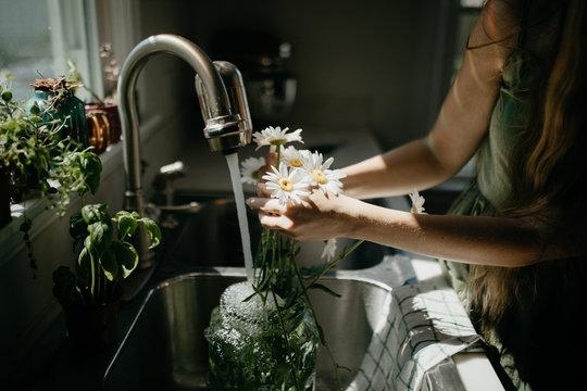 Cut flowers in a kitchen sink