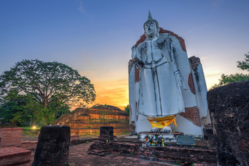 Ancient white buddha statue beautiful at sunset is a Buddhist temple It is a major tourist attraction in Phitsanulok, Thailand.