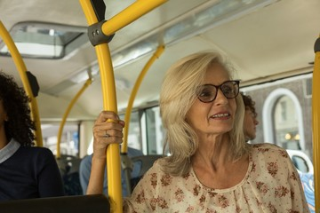 Senior woman travelling in the bus