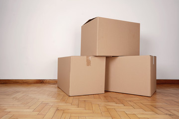 Stack of cardboard boxes in the empty room
