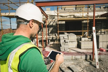 Engineer using digital tablet at the construction site