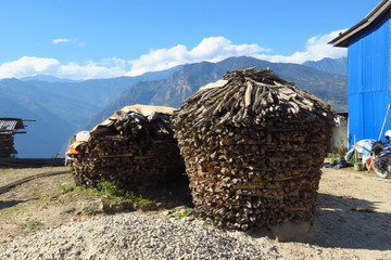 House shaped pile of wood drying in the sun, in the small village of Num, Nepal