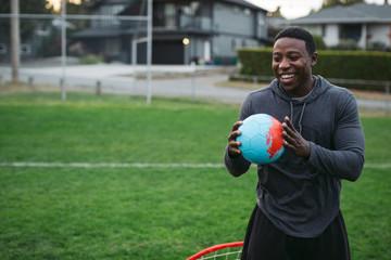 Sporty man outside in grassy field