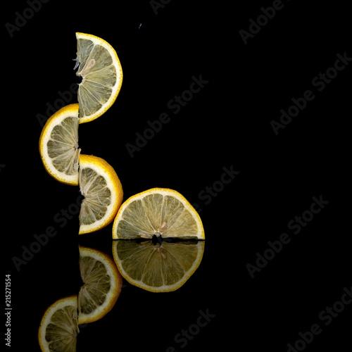 4a15e79dff Creatively balanced fresh lemon fruit slices on dark background. Unusual  photo. Seem to defy gravity. Isolated on black