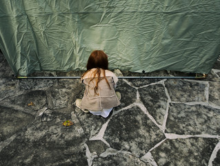 Sukkot: Girl Works To Attach Canvas Wall To Pole