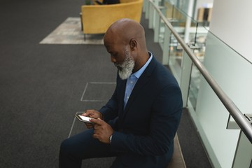 Businessman using mobile phone in the office