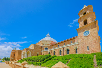 Keuken foto achterwand Oceanië Side view of St. Francis Xavier's Cathedral with dome or Geraldton Cathedral on Cathedral Ave, is the main place of Catholic worship in Geraldton, Western Australia. Sunny with blue sky. Copy space.