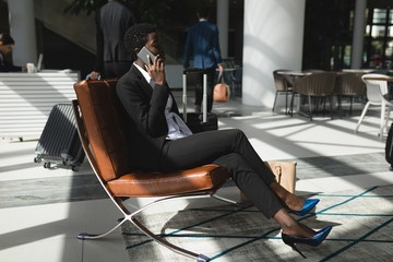 Businesswoman talking on the phone in office
