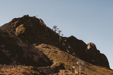 Chairlift in autumn mountains
