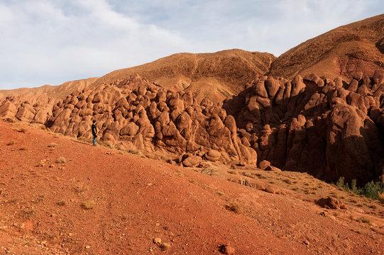 Photographer taking landscape photos in the Tamlalt cliffs