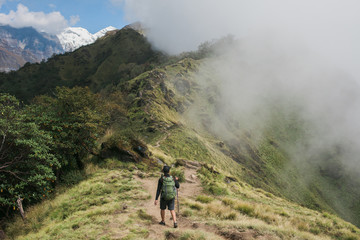 Mardi Himal Trek: Man trekking in the himalayas.