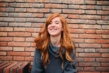 Young redhead woman laughing