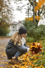 Woman picking foliage in park
