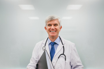 Cheerful adult doctor with papers