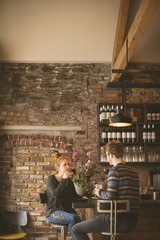 Couple having coffee at bar counter