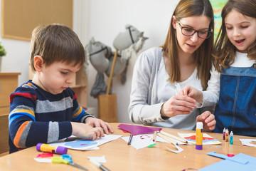 Preschool Teacher with Children at Kindergarten - Creative Art Class